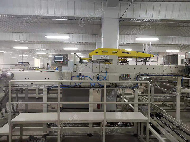 Clamping cage loader and cage unloader